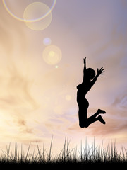 Conceptual young woman silhouette jumping happy on grass at sunset
