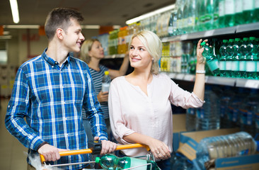 couple purchasing mineral water