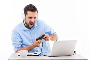 Excited man playing video games