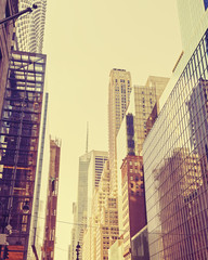 Vintage stylized photo of skyscrapers in Manhattan, NYC.