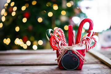 Candy canes in a basket on christmas background