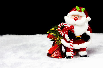 Santa Claus and Christmas bell on black background