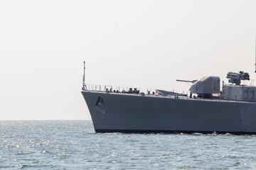 modern military ship sailing in the sea