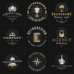 Set of Hipster Vintage Labels, Logotypes, Badges for Your Business. Crown, Helmet, Barrel, Lock, Bell, Star, Wine. Vector Illustration on Dark Textured Background