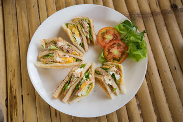 club sandwich in white dish