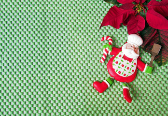 Christmas - poinsettia and funny chef Santa Claus