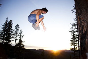 Professional slackliner Mike Payton plays around on the slackline, Blue Mountain, Missoula, Montana.