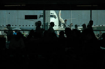 Airport traffic with people and jet