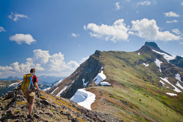 A backpacker hikes over a long mountain ridge leading to Silvertip Peak near Hope, British Columbia, Canada.