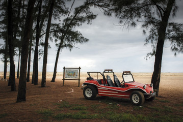 Vintage dune buggy on the coast of South Africa just after dawn.