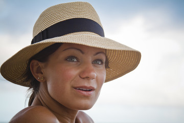 Portrait of a young woman wearing a sun hat while on vacation in Barbados.