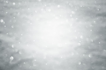 Out of focus abstract blurred winter silver snow bokeh light nature background. Lovely abstract nature New Year and Christmas Holiday copy space background.