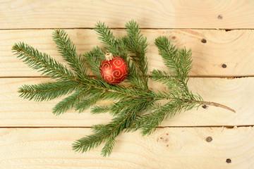 Christmas ball on pine branch