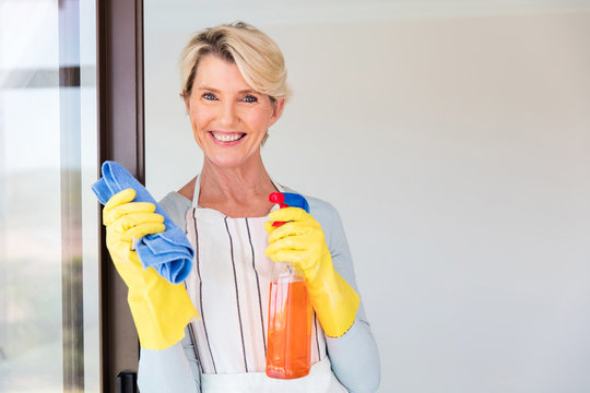 senior woman cleaning her house