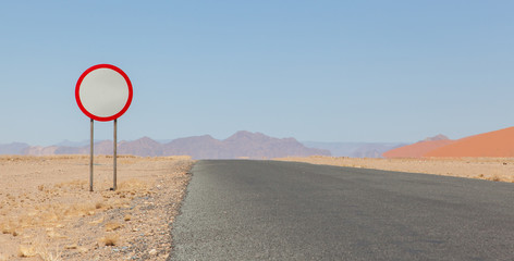 Speed limit sign at a desert road