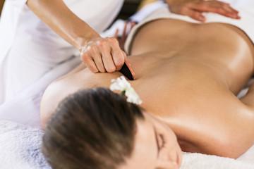 Woman enjoying massage.