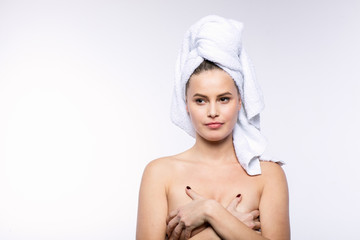 beautiful young woman with bath towel on head
