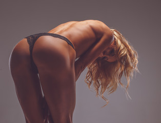 Woman's nude back and buttock.