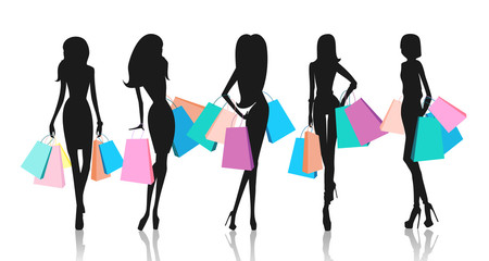 Silhouette of women with shopping bags