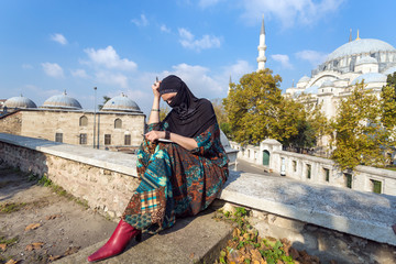 Pensively looking Middle Eastern Lady sitting in Park