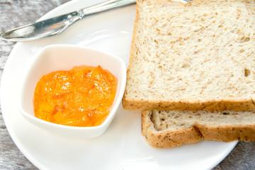 Bread with orange marmalade jam