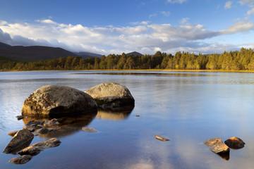 Still lake in early morning light, Loch Morlich, Scotland