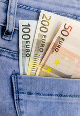 Pocket jeans full of euro banknotes