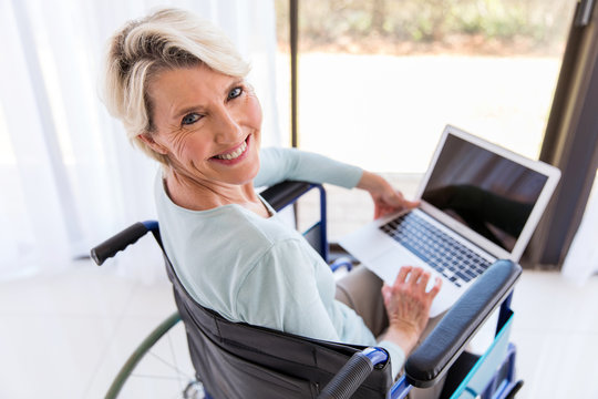 disabled middle aged woman with laptop computer