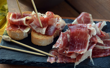 appetizer of ham Serrano with bread roasted