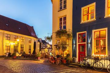 Ancient Dutch street with restaurants in Doesburg