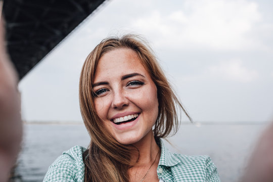 woman taking picture of herself, selfie