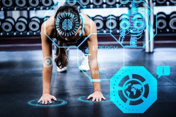Composite image of woman working out in gym