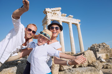 Positive young family take a sammer vacation selfie photo on ant