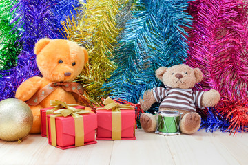 decorate Christmas and little bear on the wood floor
