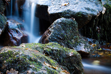 zen close up of river waterfall with rocks, long exposure effect of softness