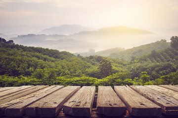 wooden table and view of mountain with sun light