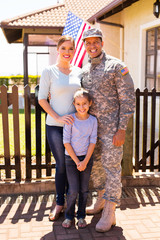 young military family standing together