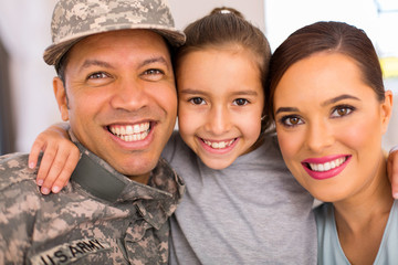 military family of three relaxing together