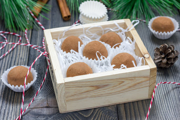 Homemade chocolate-caramel truffles in wooden box