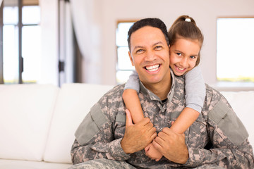 little daughter and military father
