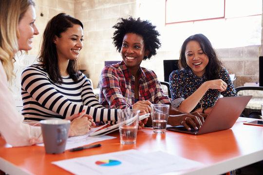 Group Of Female Designers Having Meeting In Modern Office