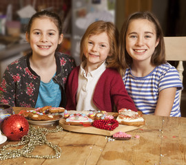 Three Sisters. Three sisters spent the afternoon making Christmas gingerbread. They worked together and created a variety of lovely biscuits.