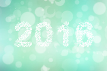 New year greeting card made of bokeh circle shape of 2016 on colorful background.