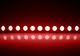 Play of red light on defocusing blur led lamps background