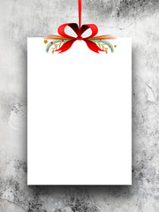 One empty rectangular paper sheet frame with Xmas ribbon decoration on grey moulded concrete wall background