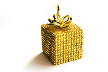 Christmas gift wrapped in gold on white bacground