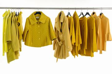 female yellow clothing on hangers