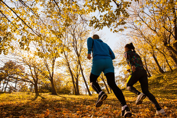 Cross-country running man and woman together