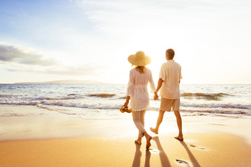 Mature Couple Walking on the Beach at Sunset