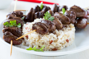 Skewered and grilled chicken hearts
